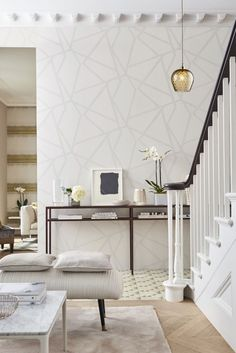 An elegant, all over wallpaper pattern featuring an abstract oriental design with beaded detailing.