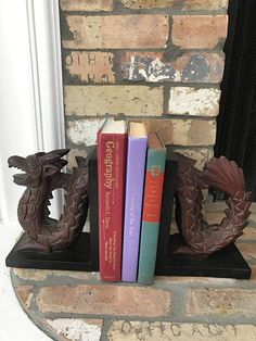 Hey, I found this really awesome Etsy listing at https://www.etsy.com/listing/512649172/pair-of-wooden-dragon-bookends-homedecor