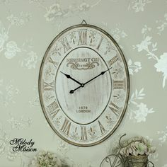 Large Cream Oval 'Kensington' Wall Clock Large cream oval wall clock in a vintage style with Roman numerals A large clock that will make a statement with it's bold design and scrolled detailing Made from wood with cream distressed finish Hook on the back for wall hanging, takes x1 AA battery