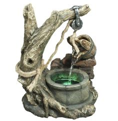 This hand-painted, traditional bucket and well fountain features real rope accents. high x wide x deep. Rustic bucket and well table fountain. A charming, natural look for farmhouse or rustic style rooms. By Alpine. Style # at Lamps Plus. Tabletop Water Fountain, Indoor Water Fountains, Garden Fountains, Fountains For Sale, Indoor Water Features, Robot Animal, Aging Wood, Grey Flooring, Decoration