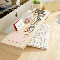 Over the keyboard desk organizer. Clean look, and makes the most of a crowded desk's minimal space!!