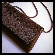 Brown Special Occasion Purse Copper Beads Beautiful and elegant chocolate brown purse with copper beads. Fabric is a satin like material and that can be used as a shoulder bag or a clutch. The brand is La Regale and it is in good condition with very minor spots. La Regale Bags Clutches & Wristlets