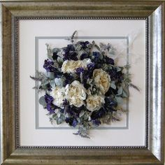 A birds eye view of #preserved #white peonies and purple #stocks