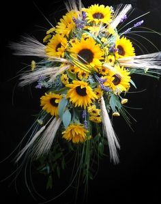 Bridal bouquet of sunflowers, lavender, wheat, Italian ruscus and bear grass by Emil J Nagengast Florist, Albany, NY.