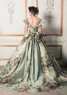 This silky green ball gown has an off the shoulder look with many different colours of detailing throughout the dress