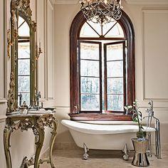 feminine bath - claw foot tub, chandelier, window, mirror