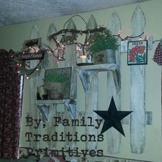 Old picket fence panel we made with shelves. Client decorated with her decor. Www.facebook.com/familytraditionsprimitives