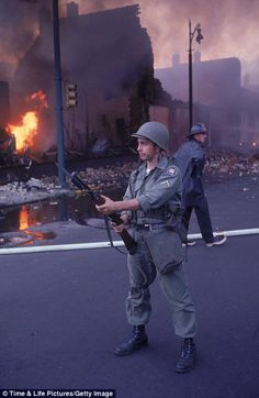 Soldier: A National Guardsman patrols the streets after the shocking race riots.