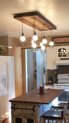 The chandelier gRIZZLY BEAR CHANDELIER industrial wood rustic wood - 4 to 12 industrial cage pendant barnwood chandelier Outdoor Kitchen Design, Rustic Kitchen, New Kitchen, Kitchen Decor, Kitchen Ideas, Design Kitchen, Farmhouse Kitchen Lighting, Kitchen Modern, Kitchen Layout