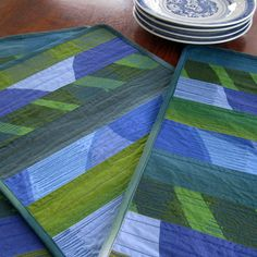 Transform your table decor with a contemporary mix of blue and green Marimekko screen prints. Machine quilted rows create interesting pattern and texture on these beautiful prints – there are five different Marimeko prints in each placemat. The colors are bold and exciting! The fabric on the back is a teal blue Marimeko print.