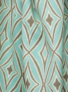 "Outdoor - Centro, Mist From the Sun & Shade collection by Waverly is an ikat geometric outdoor fabric in aqua mint blue, taupe and cream. Pattern repeat is 8.5"" vertical by 4.5"" horizontal. Made of a 100% Spun Polyester Duck (canvas style), medium upholstery weight fabric. Perfect for outdoor pillows, foam bench, cushion or furniture covers and more. Also suitable for high traffic indoor such as dining room seat or stool cushions as well."