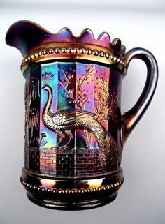by Northwood Peacock at the Fountain blue carnival glass pitcher