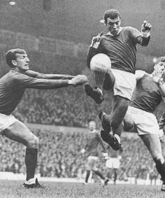 20th January 1968. Manchester United duo Alex Stepney and David Sadler block off Sheffield Wednesday's Sam Ellis