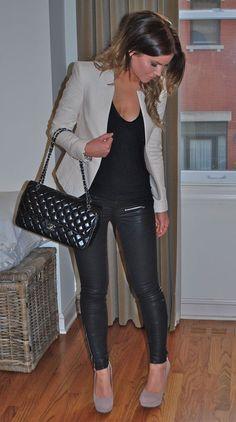 Shop this look on Lookastic:  https://lookastic.com/women/looks/blazer-tank-leggings-pumps-crossbody-bag/4613  — Black Leather Leggings  — Black Quilted Leather Crossbody Bag  — Grey Blazer  — Black Tank  — Grey Suede Pumps