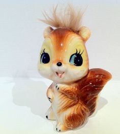 ceramic squirrel with fuzzy hair! I may remember these little guys!