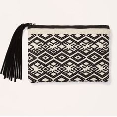 LOFT tassel Pouch LOFT tassel Pouch is bnwt still in bag - super cute geo print! Love it SOLD OUT! Absolutely no returns! Og price is $25+tax+shipping=$33 LOFT Bags Clutches & Wristlets