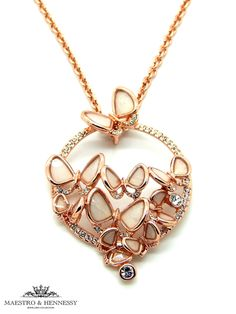 Mother of Pearl butterflies sitting atop a crystal pave rose gold plated circle on long necklace. Rose gold plated butterflies with white mother of pearl inlay cluster in a group upon the middle of the pendant. Large white crystals set in rose gold offsets the design with playful butterflies on a garden of crystals. Rose gold extendable chain and lobster clasp for perfect positioning. This stunning piece is part of a butterfly collection with matching rings and earrings.