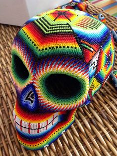 Skull made by Huichol. Indians in Mexico (Jalisco, Nayarit, Durango, Zacatecas. Mexican Skulls, Mexican Folk Art, Mexican American, Crane, Seed Bead Art, Sugar Skull Art, Sugar Skulls, Cow Skull, Yarn Painting