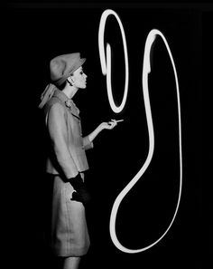 William Klein - Dorothy Blowing Light Smoke Rings, Paris, 1962