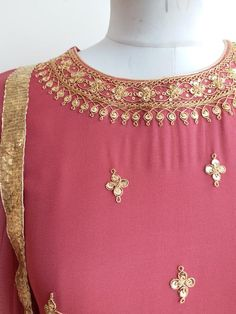 """Featuring this beautifully flared Anarkali Suit in soft Burgundy color with intricately embroidered motifs of dori and sitara work on bodice and sleeves. The dupatta comes inmatching colour with traditional golden lappa border. Length 56"""" Fabric : Viscose Georgette Lining : Shantun Dupatta : Soft Net Care: Dry clean on"""