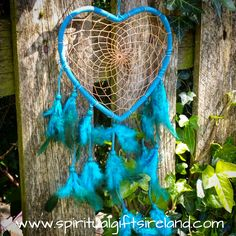 Fluffy Blue Heart Feather Dreamcatcher  The Dream Catcher is a Native American talisman which according to the legends protects the sleeper and his dreams from evil spirits. Native ancestors believe the night air is filled with both good and bad dreams. The dreamcatcher web filters out all bad dreams, allowing only good thoughts to enter your mind. The good spirit dreams float down the sacred feathers into the psyche of the dreamer while the bad spirit dreams are held in the center web.