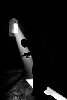 Monk in prayer at the Benedictine Abbey of Ganagobie, France.