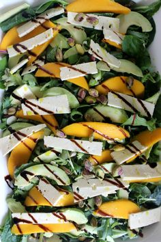 MANGO AND FETA SUMMER SALAD. Delicious and simple with sweet mango, salty feta, crispy greens and crunchy pistachios. The perfect bring-a-plate salad to share with guests this Summer or Christmas.