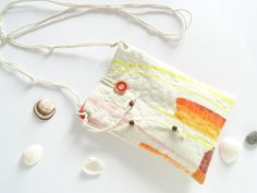 Small hipster bag to carry phone, coin purse, sunglasses, etc. at a party or when travelling. + padded and quilted + closes with a button and string + cord strap - 47 (120cm) + dimensions - H 8.5 (21.5cm) *** W 5.9 (15cm)  Please, feel free to contact me with any questions you may have!  Back to shop: www.etsy.com/shop/persabags  All of my products are handmade by me with great care and attention to detail.  Thank you for choosing Handmade and supporting my family