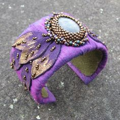 Labradorite Cuff Bracelet with Purple Dupioni Silk and Bead Embroidery by windyriver on Etsy https://www.etsy.com/listing/116964524/labradorite-cuff-bracelet-with-purple