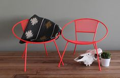 Pair of  MCM Hoop Chairs in Dayglow Coral Finish Vintage Upcycled Salterini Style. $1,200.00, via Etsy.