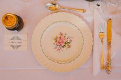 Ornate flatware and scalloped floral print plates (photo by Lara Hotz)