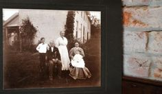 This photo of Daniel Harshbarger and his family hangs in the Harshbargers' home. The photo was taken in the 1880s.