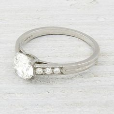 Image of Vintage .79 Carat Tiffany & Co. Diamond Engagement Ring.  LOVE the low profile setting & round diamond