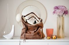 pic: thecoveteur from the home of canadian creative director jenn cranston via the coveteur . the jonathan adler ceramic , the faded balenc. Leather Backpack, Leather Bag, The Coveteur, Balenciaga Bag, Wedding Songs, Creative Director, Fashion Models, Colours, Purses