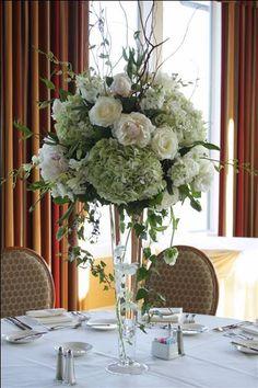 Tall arrangement: hydrangeas, roses, greenery/   Deland Florida wedding flowers/ Volusiacountyweddingflowers/ www.callaraesfloralevents.com