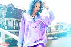"""Pastel Galaxy Cat Jumper  This is a Collaboration with Funky Catsterz and JapanLA.  Intentional, Loose fit. Scoop neck.   Materials: 81% Polyester 14% Rayon 5% Spandex  Medium Measurements: Bust 44"""" Length 25"""" Sleeve Length 24"""" Neck 9.5""""  Made in the U.S.A.  JapanLA is a Kawaii..."""