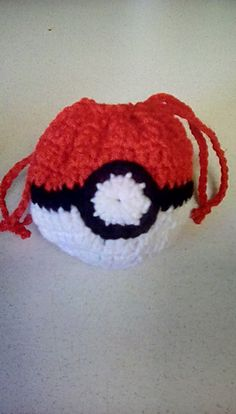 This pattern is for a drawstring style Pokémon inspired Pokéball pouch. It is great for keeping small toys or trinkets. (Not recommended for coins at this size) To increase or decrease size, use a different sized hook and or yarn. I used Red Heart super savor solids in Red, Black, and White.