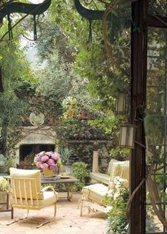 Romantic secret garden room.  I love the overgrown plant materials...lends romance and age to this wonderful space!