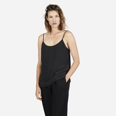 A feminine, clean-cut camisole in silk  100% silk Fabric is a washed crepe-de-chine that shows a subtle lustre on darker colors Features adjustable dyed-to match sliders on straps Partially lined at top Dry clean only