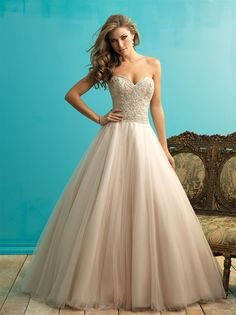 STYLE: 9262  This gown is the dreamy essence of a ballgown, with layers and layers of English net composing the skirt.  Colors: White/Silver, Ivory/Silver, Champagne/Silver Fabric: English Net Size: 2 - 32