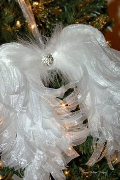 """Cameo Cottage Designs: Shabby Tattered Angel Wing Tutorial  The wing base (the cardboard) measured 10""""W at the widest part of the wings x 8""""L. The finished wings measure approximately 13""""W x 12 1/2""""L. 70 yards of organdy ribbon cut into 6"""" strips"""