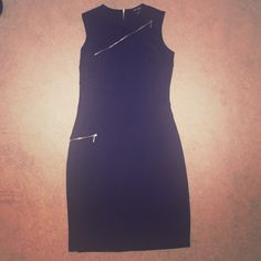 Classy Zipper LBD  Such a classy Mid-length LBD with beautiful zipper details. Comes about 2 inches below the knee (I'm 5'3)Only worn once, perfect condition. Dresses Midi