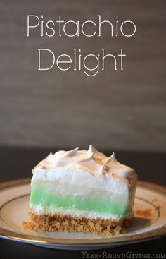 Pistachio Delight is a creamy layered pudding dessert. This recipe for Pistachio Delight has a graham cracker crust, layers of pistachio and white chocolate pudding and sweetened cream cheese. Then topped off with whipped topping.