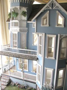 Wow! I love the little hanging ferns! This dollhouse is gorgeous! Unfortunately no link to the original!