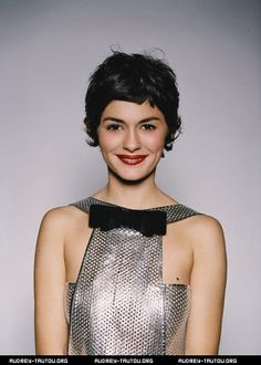 Audrey Tautou's short hair works because it creates a rounded shape at the top with a rounded mini-fringe and rounded volume on top which softens the diamond. Wispy bits below her ears balance out the shape.