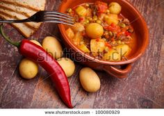 Sold at Shutterstock : International Cuisine - Romanian Recipes - Country stew with vegetables and pork chops.