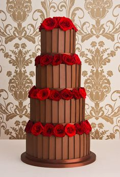 "'Belgian' chocolate wedding cake: Chocolate fudge cake,   Amedei Toscano chocolate buttercream,   Belgian chocolate plaques.    Price as shown:  4 tiers (6"", 8"", 10"" & 12"")  £995 + flowers"