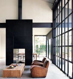 Google Image Result for http://www.thebohmerian.com/wp-content/uploads/2011/09/a-modern-black-fireplace.jpg