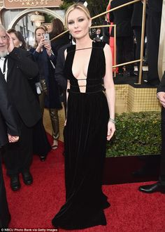 Enchanting: The 33-year-old paired the floor-length gown, which cinched at her waist, with...