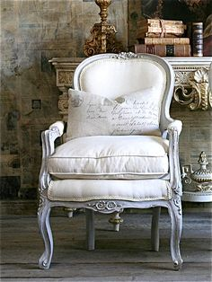 love the white chair, the cushion, the old ornate mantle, the old books, old newspapers on the wall - just everything! ZsaZsa Bellagio: french